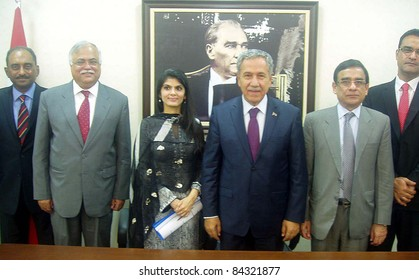 ANKARA, TURKEY - SEPT 08: A group photo of Pakistan Delegation led by Senator Syeda Sughra Imam with Turkey Deputy Prime Minister, Bulent Arinc during meeting in Ankara on September 08, 2011.