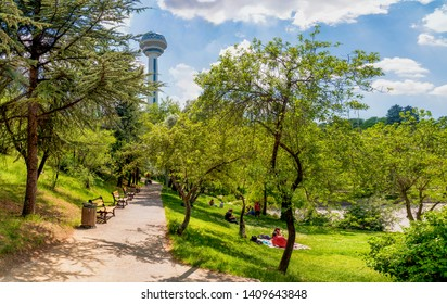 Ankara/Turkey- May 26 2019: People have picnic at Botanical Garden and Atakule in background in the spring