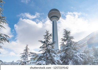 Ankara/Turkey-December 13 2018-Atakule tower in winter time and trees under snow in Botanic Park.