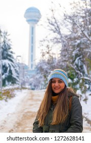 Ankara/Turkey-December 30 2018: Woman looks camera and Atakule in background in winter, Ankara/Turkey