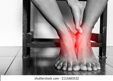 Ankle pain or varicose veins on a leg in women. ,Health care ,medical ,lifestyle and People concept. painful point or Broken twisted ankle. Hands woman touching foot in pain due to sprained ankle