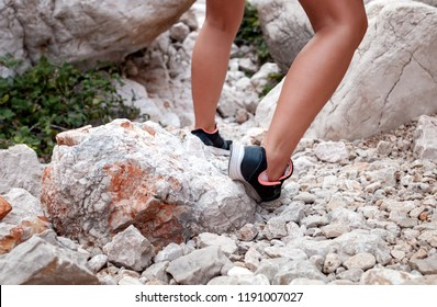 Ankle sprain while hiking on rocky trekking trail in mountain
