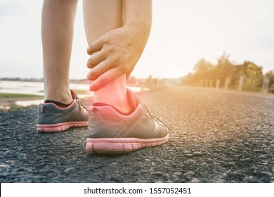 Ankle twist sprain accident in sport exercise running jogging.sprain or cramp Overtrained injured person when training exercising or running outdoors.