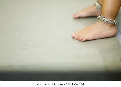 Anklets in little child girl leg