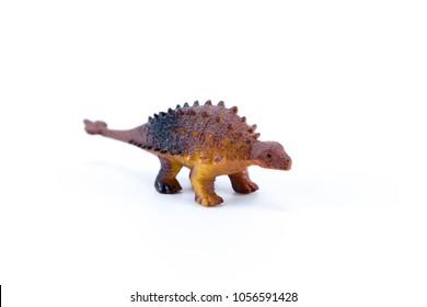 Ankylosaurus funny toy mini macro dinosaur isolated in white background