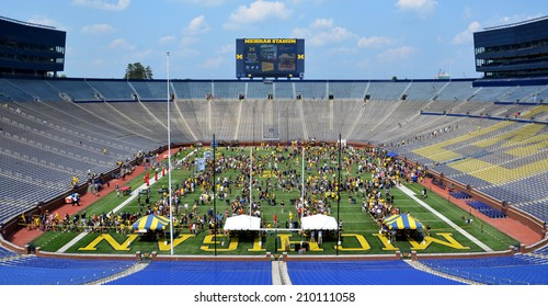 ANN ARBOR, MI - AUGUST 10:  Visitors meet players and others at Michigan stadium during Michigan Football Youth Day on August 10, 2014 in Ann Arbor, MI.