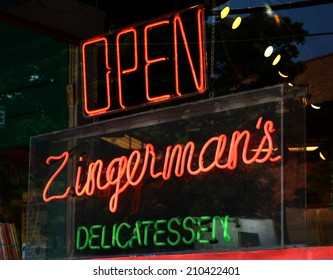 ANN ARBOR, MI - AUGUST 3: Neon sign in Zingerman's deli window in Ann Arbor, MI on August 3, 2014.  Zingerman's co-owner Paul Saginaw has lobbied to increase the minimum wage.
