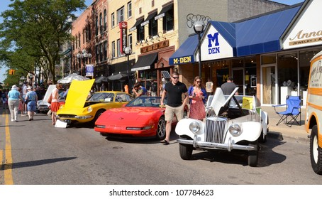ANN ARBOR, MI - JULY 13: 1955 MG, 1994 Corvette, and 1970 Ferrari at the Rolling Sculpture car show July 13, 2012 in Ann Arbor, MI.