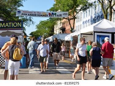 ANN ARBOR, MI - JULY 20: Crowds enjoy the Ann Arbor Summer Art Fair in Ann Arbor, MI. Organized by The Guild of Artists and Artisans, it is one of four art fairs in Ann Arbor July 20, 2011.