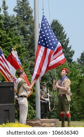 ANN ARBOR, MI - MAY 27: Unidentified boy scouts raise the flag at the Memorial Day observance on May 27, 2012 at Arborcrest Memorial Park in Ann Arbor, MI