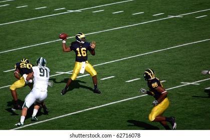 ANN ARBOR, MI - OCTOBER 09: Denard Robinson throws a pass during the Michigan vs. Michigan State football game October 9, 2010 in Ann Arbor, MI. Michigan lost the game 34-17.