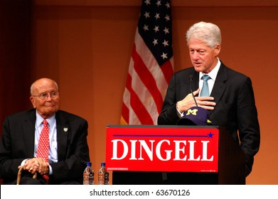 "ANN ARBOR, MI - OCTOBER 24: Former President Bill Clinton speaks at a ""get out the vote"" rally with Congressman John Dingell of Michigan on October 24, 2010 in Ann Arbor, MI"