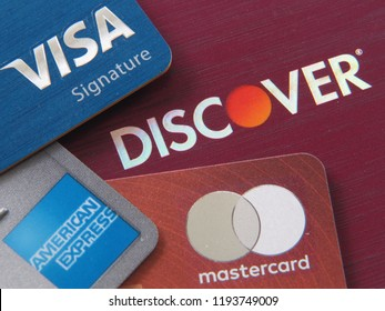 ANN ARBOR, MI – Sep 27, 2018: Macro photo of stack of credit cards with the logo of major networks visible: Visa, Discover, American Express, and Mastercard