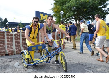ANN ARBOR, MI - SEPTEMBER 26: University of Michigan football fans pose with their Champion's Chariot outside the stadium before the BYU game on September 26, 2015.