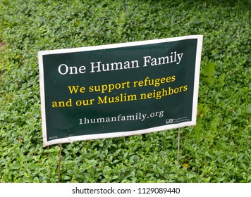 ANN ARBOR, MI / USA - JUNE 9, 2018:  One Human Family sign supporting refugees and Muslim neighbors on a yard.