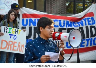 ANN ARBOR, MI / USA - SEPTEMBER 8, 2017: DACA student Javier Contreras speaks at a pro - DACA rally at the University of Michigan.