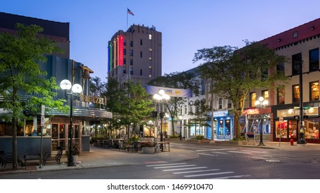 Ann Arbor, Michigan / USA - August 4, 2019: Image at corner of Main Street and Liberty St. looking north.  Iconic Pretzel Bell restaurant and the First National Building anchor the image front to back