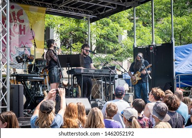 Ann Arbor, Michigan / USA - July 25, 2019:  Andrew Horowitz of Tally Hall is joined by Laith Al-Saadi during the 12th Annual Sonic Lunch Free Concert series on Liberty Street in downtown Ann Arbor.