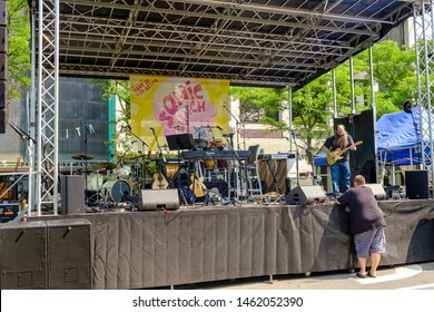 Ann Arbor, Michigan / USA - July 25, 2019: Laith Al-Saadi warms up prior to playing street concert with Andrew Horowitz of Tally Hall at the 12th Annual Sonic Lunch Free Concert series in Ann Arbor.