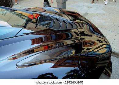 Ann Arbor, Michigan/USA - July 2018: Car reflection during a vintage car show in downtown Ann Arbor