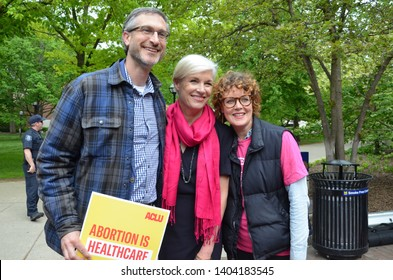 ANN ARBOR, MI/USA - MAY 21, 2019: Cecile Richards poses with Ann Arbor mayor Christopher Taylor and wife Eva Rosenwald before the Ann Arbor Stop the Bans protest organized by Planned Parenthood.