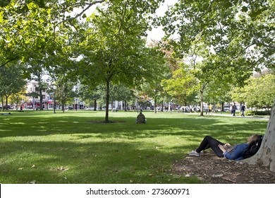 ANN ARBOR, USA - SEPTEMBER 25, 2014. Students relaxing on the meadow at Ann Arbor campus, Michigan, USA.