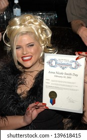 """Anna Nicole Smith receives a proclamation from the City of West Hollywood declaring it """"Anna Nicole Smith Day"""" at The Abbey in West Hollywood, CA 02-18-03"""