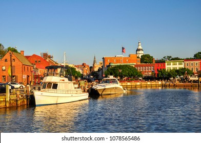 """Annapolis Harbor, nicknamed """"Ego Alley"""" on a sunny summer morning. Colonial buildings line the streets, including the Maryland State Capital dome, the largest wood dome built without nails in America."""