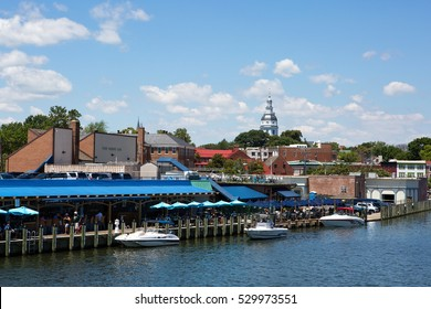 ANNAPOLIS, MARYLAND - JULY 11, 2016: View of downtown Annapolis, Maryland, USA, waterfront with the dome of the Maryland State House building in the distance on July 11, 2016.