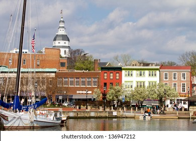 ANNAPOLIS, MARYLAND, USA - APRIL 12, 2013: Tourists shop along the waterfront in historic downtown Annapolis, Maryland, USA, the state capital, dome visible in the background, on April 12, 2013.
