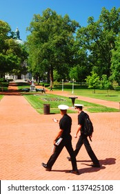 Annapolis, MD, USA May 8, 2011 Two Cadets at the US Naval Academy walk through Radcliff Terrace in Annapolis, Maryland