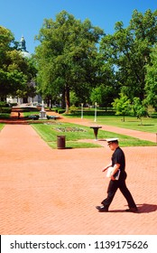 Annapolis, MS, USA May 8, 2011 A young male midshipman walks Radcliffe Terrace on his way to the noon formation at the United States Naval Academy in Annapolis, Maryland