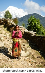 Annapurna Circuit, Gandaki Pradesh, Nepal 10/19/2014 Old smiling Nepali woman in traditional clothing on Himalayan mountain trail