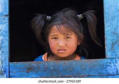 ANNAPURNA CIRCUIT, NEPAL - APRIL 20, 2008: Tibetan girl from the village of refugees in the Himalayas.