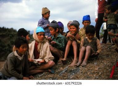 ANNAPURNA HIMAL, NEPAL - DEC 28, 1977 -Nepalese children greet trekking tourists, Nepal