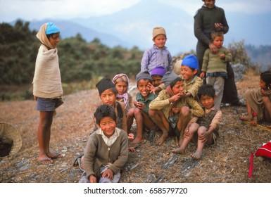ANNAPURNA HIMAL, NEPAL - DEC 28, 2007 -Nepalese children greet trekking tourists, Nepal
