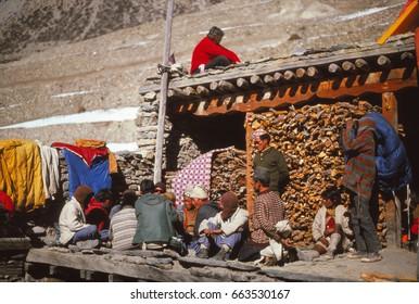 ANNAPURNA HIMAL, NEPAL - DEC 28, 1977 - Nepalese porters on a trek in the Annapurna Himal in Nepal