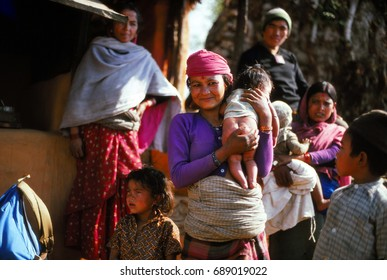 ANNAPURNA HIMAL, NEPAL - DEC 28, 1977 - Nepalese mothers with their children, Annapurna Himal in Nepal