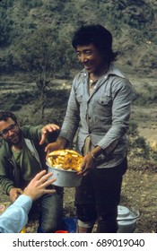 ANNAPURNA HIMAL, NEPAL - DEC 28, 1977 - Serving Indian puris and roti for lunch, Annapurna Himal in Nepal