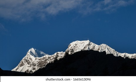 Annapurna mountain massif with Annapurna II peak (on the left), as seen from Humde village in Marshyangdi valley, Around Annapurna Trek, Manang district, Nepal Himalayas, Nepal.