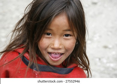 ANNAPURNA, NEPAL – MARCH 30 : Young Nepali girl with light hair strands which is a proof of malnutrition in Annapurna, Nepal March 30, 2008. Annapurna trail is well known for its trekking activities.