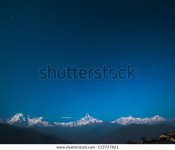 Annapurna range with Fishtail Mountain (Machapuchare Mountain - 6997m) in the middle with other Annapurna Mountains on the left and right from Dhampus Gurung Cottage (1670m or 6680ft from sea level).