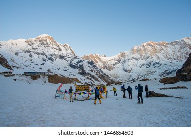 Annapurna Sanctuary - Nepal : April-12-2019 : Group of tourist trekkers reached to Annapurna base camp (4,130 m) in morning with spectacular view of Annapurna massif.