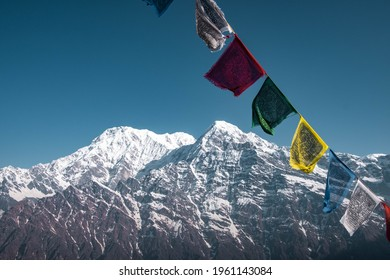 Annapurna south and Buddhists flags of wind. Early morning view on the  Annapurna south and Huinсhuli mountains from the Mards Himal range.