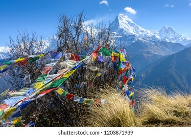 The Annapurna South with prayer flags in the foreground, seen from Poonhill, in Nepal