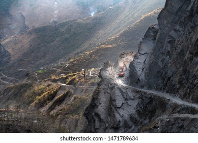 Annapurna trail/Nepal-28.07.2019: Road is blocked by landslide and excavator cleaning it