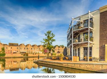 Anne Frankkade, Alphen aan den Rijn, South Holland, Netherlands, August 23, 2019: Corner houses with balconies where Aarkanaal flows into Oude Rijn