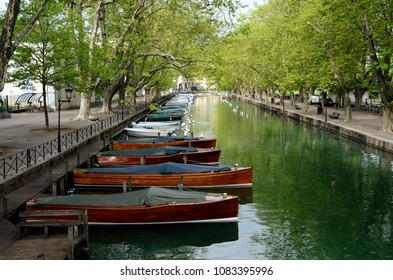 Annecy city, Thiou canal and wooden boats, Savoy, France, landscape of Love's bridge