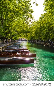 Annecy / France - 06 02 2018: Boats tied up in Le Vassé channel with intense colours and reflicting sunlight