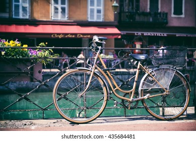 Annecy, France - 07.02.2015 - A famous landmark. Summer season. A bicycle leaning a rail by the river in the city centre